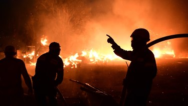 Fire burns a house in Adames area, in northern Athens, Greece, Tuesday, August 3, 2021