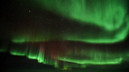 Breathtaking view of Southern Lights captured above the clouds