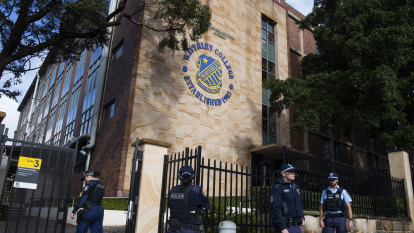 Police outside Waverley College on Tuesday after a student was diagnosed with COVID-19.