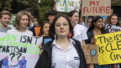 'We will never back down': 80,000 strike in Sydney over climate change
