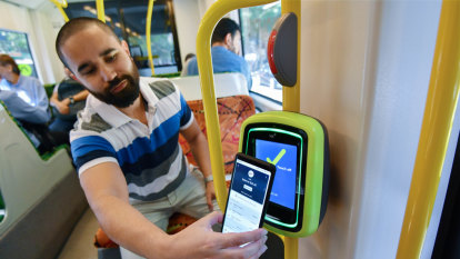 Swiping your phone to catch the train: a tale of two cities