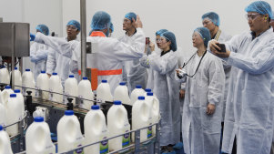 Officials and members of Chinese state owned media companies visit the A2 Milk factory in Sydney.