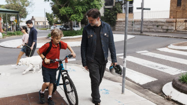 Nick Smith picking his son Harper up from school on Friday.