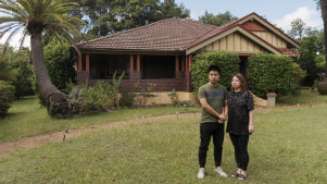 Victor Yang and his wife Fiona outside their Denistone home.