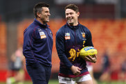 Lions assistant coach Dale Tapping (left) has joined Essendon.