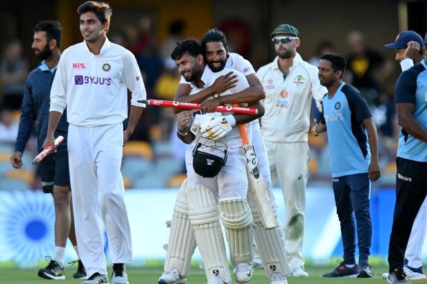 Rishabh Pant celebrates victory with his teammates.