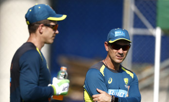 Justin Langer, right, and Tim Paine.
