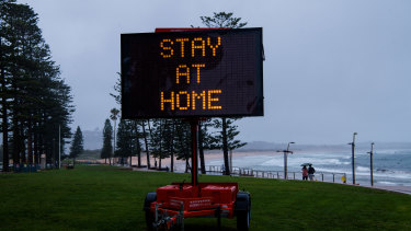 COVID ALERT sign displayed at Dee Why beach.