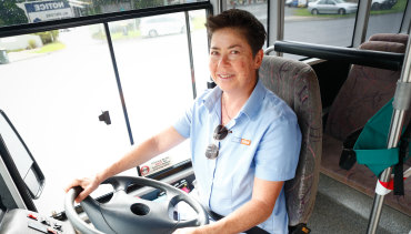 """""""I really love it"""": Pauline Menczer at the wheel of the school bus she drives for a living."""