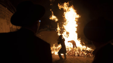 Ultra-Orthodox Jewish youths stand next to a bonfire in Jerusalem to mark the Lag B'Omer holiday, marking the end of a plague said to have decimated Jews during Roman times.