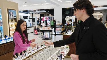 No more self service ... Kent Vaughan assists Nour Abbas with fragrance at David Jones' Sydney store.