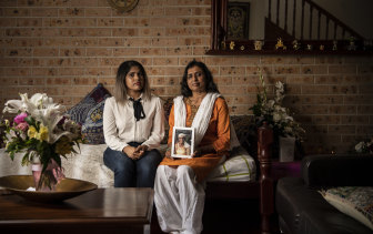 Charishma Kaliyanda with her mother Bhanu Chottera. Bhanu is holding a photo of her mother Gangamma Chottera who passed away last week in India.