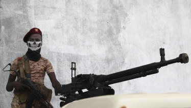A Yemeni soldier stands guard in Mukalla, Yemen, last month.