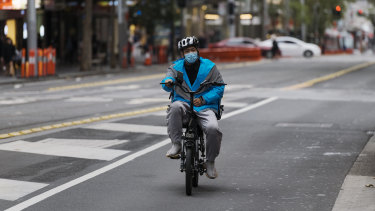 A food-delivery cyclist working during the coronavirus lockdown in Sydney's  CBD this week.