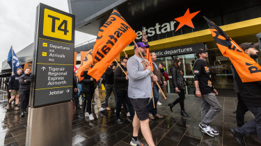 Jetstar workers and union officials protest at Melbourne Airport.