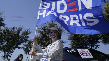 A woman shows her support of Democratic presidential candidate former vice-president Joe Biden by holding a flag in Plano, Texas.
