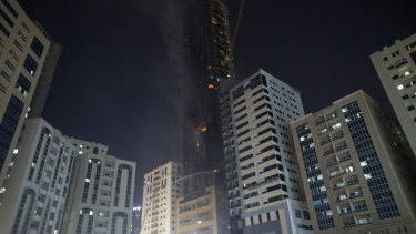 Civil defence forces extinguish a fire that broke out at a high-rise building in Sharjah, United Arab Emirates.