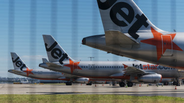 Jetstar jets grounded at Sydney Airport. Cheap fares could be used to stimulate demand once travel restrictions lift.