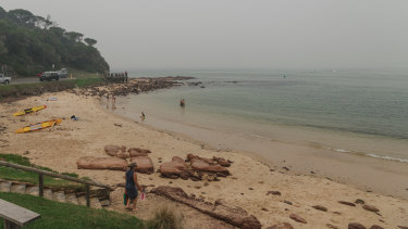 Merimbula's Bar Beach is usually crowded with tourists in January.