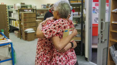 Ms Hunt received a gift from a staff member, whom she hugged straight after.