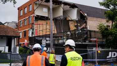 A major section of the four-storey building in Crows Nest collapsed after workers fled on Monday afternoon.