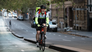 Heading through the city: Glenn Asquith who rides from Bass Hill to near the Queen Victoria building four days a week then home at night.