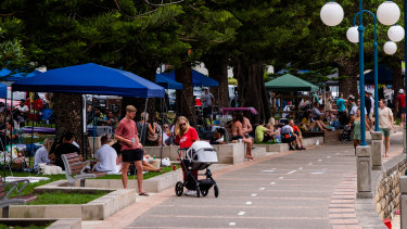 Groups gather in Manly on New Year's Eve. Experts won't know for days how the celebrations will affect the outbreak.