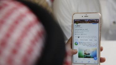 A man reading twitter in a coffee shop in Jiddah, Saudi Arabia.