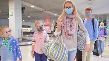 Edwina Rouse and her four children arrive from Sydney into Melbourne on Saturday morning.