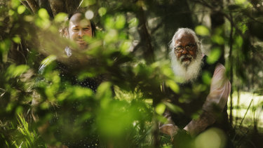 Musical journey: Damian Barbeler and Yuin elder Uncle Max Harrison in the Woronora.