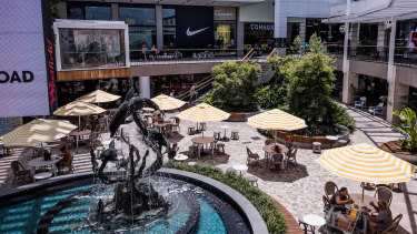 Westfield Warringah Mall was much busier on Thursday than earlier in the week and despite stay at home orders many people were seen lounging at cafes and shopping for non-essential items.