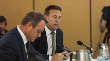 Liberal MP Jason Falinski and House Economics Committee chair Tim Wilson.