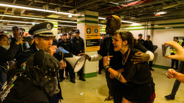 The woman confronts police.