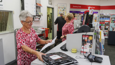 """Janette Hunt is postal manager of Batemans Bay post office. """"We were here with an ear to listen,"""" she says."""