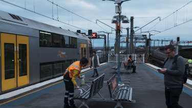 Seating is cleaned on Milsons Point Train station platform on Monday.