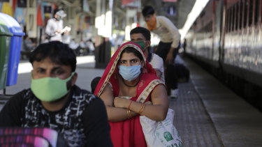 India on Friday ran the first train service for thousands of migrant workers desperate to return home since it imposed a nationwide lockdown to control the spread of the coronavirus.