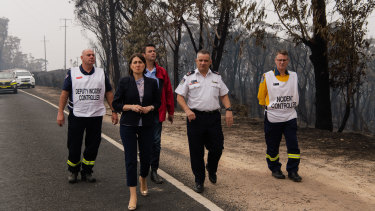 NSW Premier Gladys Berejiklian and RFS Deputy Commissioner Rob Rogers visit The Darling Causeway, Mt Victoria on Monday.