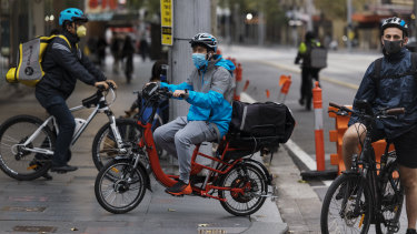 Food delivery cyclists working during the coronavirus lockdown in Sydney's CBD.