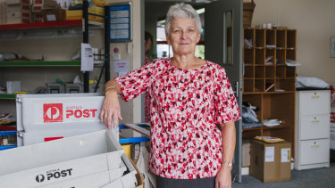 Janette Hunt is the postal manager of Batemans Bay post office where, despite the tragedy the fires have wreaked, it's business as usual.