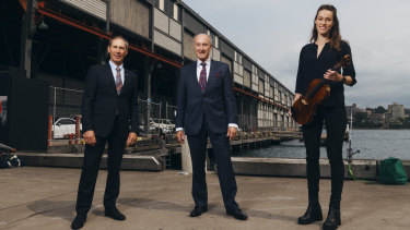 Australian Chamber Orchestra chairman Guido Belgiorno-Nettis, Platinum Asset Management director Kerr Neilson and ACO violist Elizabeth Woolnough outside Pier 2/3.