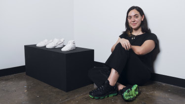 Artist Gillian Kayrooz with her ceramic sneakers.