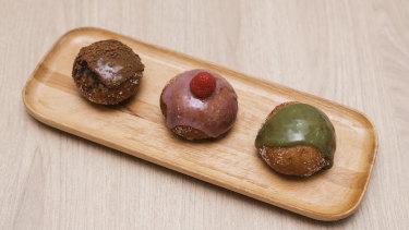 Comeco Foods' signature sourdough doughnuts - (from left) mocha custard, raspberry custard and macha custard.