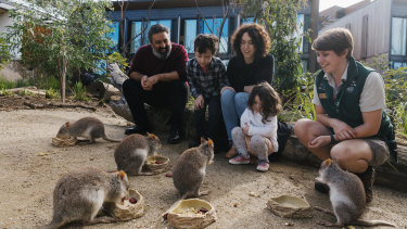 Mick and Rachael Bruzzese, with their children Cassius and Paola, at Taronga's Wildlife Retreat.