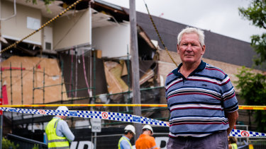 Financial planner Tom Roche outside the wreckage of the building he has worked in for almost 20 years.
