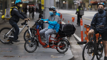 Food delivery cyclists working during the coronavirus isolation lockdown in the Sydney CBD.