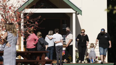 Members of the Margaret River community leaving flowers at the community resource centre.
