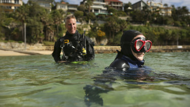 Ashlee Florrimell, who has paraplegia, surfaces with instructor Steve Bates after a dive at Shelly Beach in Manly.