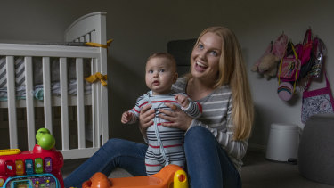 Au pair Erika Palsson looks after nine month old Jayden while his mother works from home.