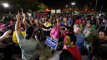 Trump supporters rally outside the Maricopa County Recorders Office in Phoenix, Arizona.
