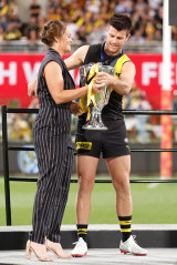 Ash Barty presents the 2020 AFL premiership cup to Trent Cotchin in Brisbane.